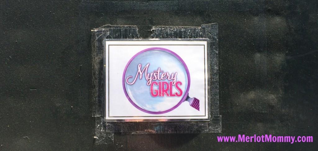 mystery girls studio sign