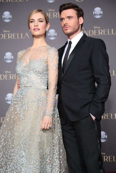 """Lily James and Richard Madden arrive as Disney Pictures presents the world premiere of """"Cinderella"""" at the El Capitan Theatre in Los Angeles, California on Sunday, March 1, 2015. .(Photo: Alex J. Berliner/ ABImages)"""