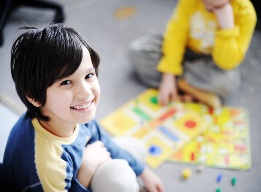 Two kids playing a game - family game night