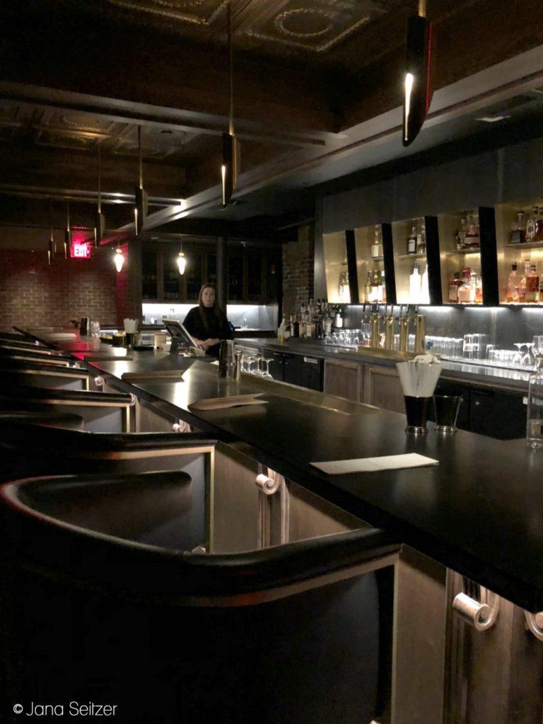 dark bar of the Undercroft speakeasy in Bentonville, Arkansas