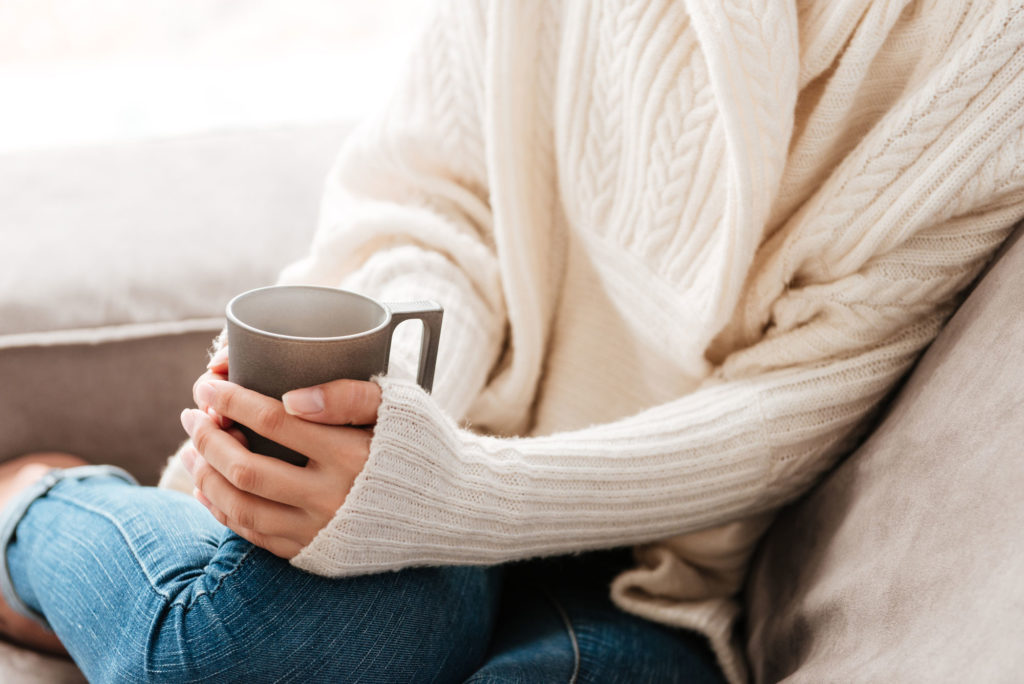 Improve Your Home Internet with Verizon 5G - woman sitting on sofa with coffee cup