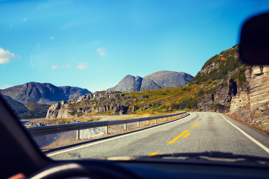 Driving a car on mountain road, Norway