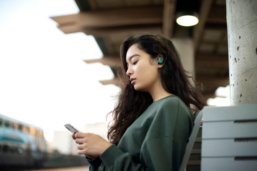 woman wearing Skullcandy Push Earbuds