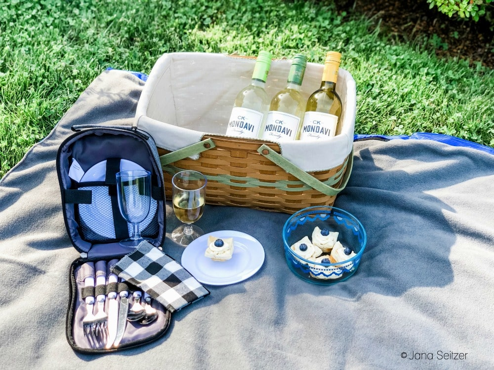 wine bottles and tarts in a picnic