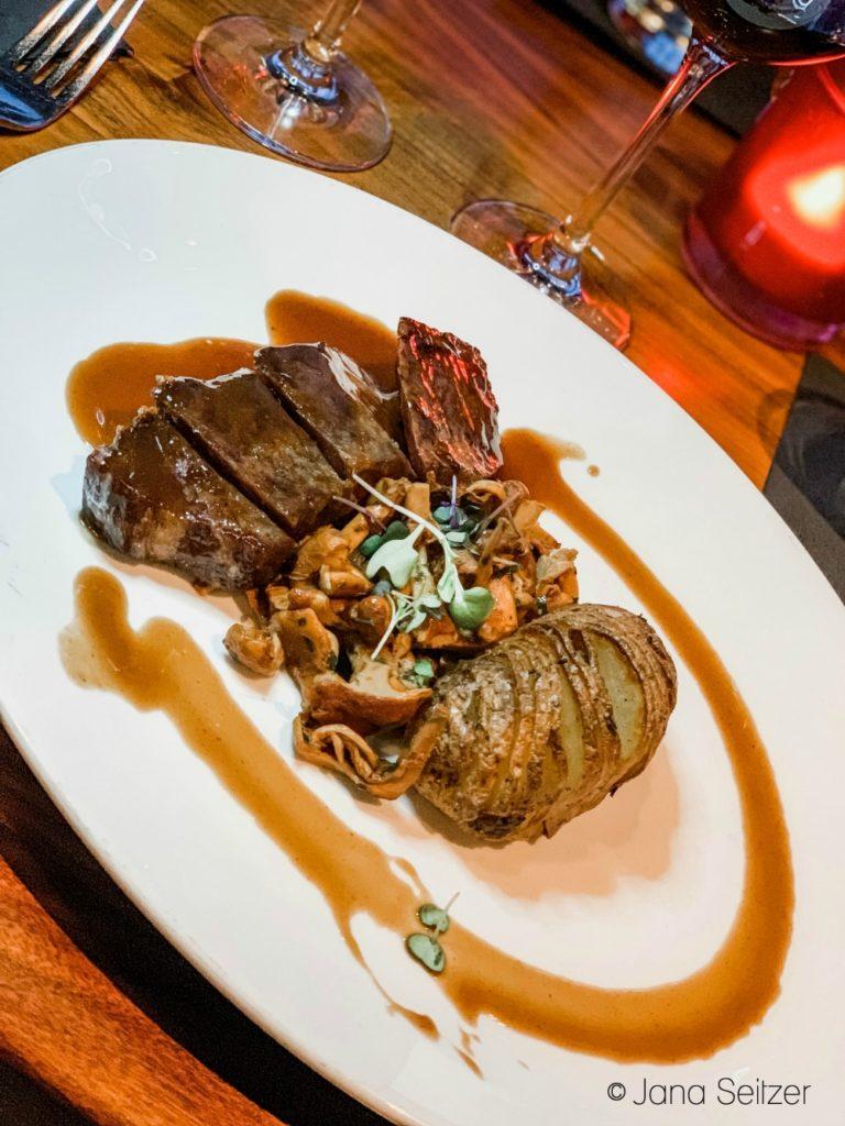 45-Day Dry-Aged Prime New York Strip Wild Mushrooms, rosemary hassle back potato, roasted shallot jus