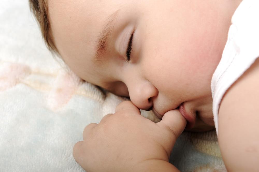 baby sleeping sucking thumb