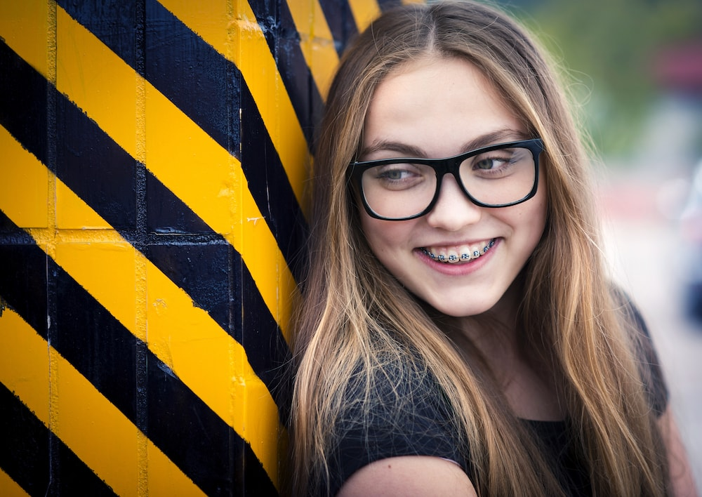 Urban hipster girl with braces